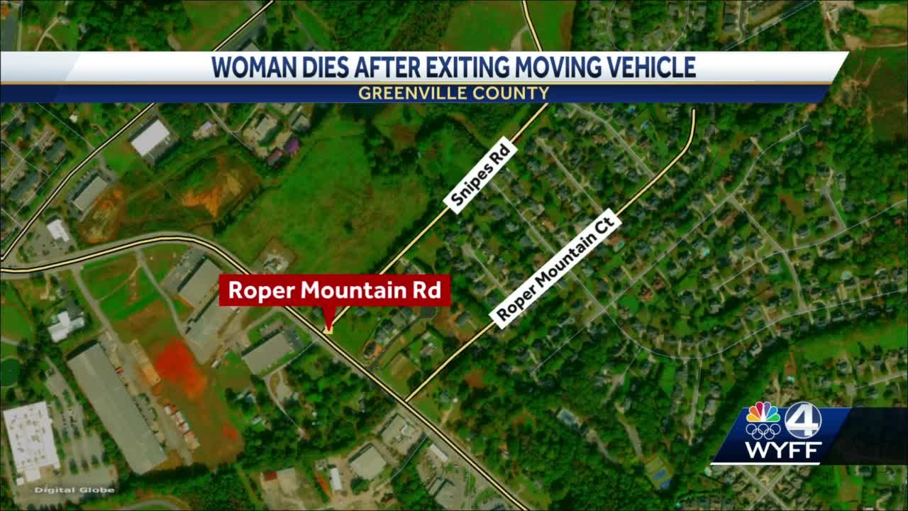 Woman dies after she exits moving vehicle, coroner says