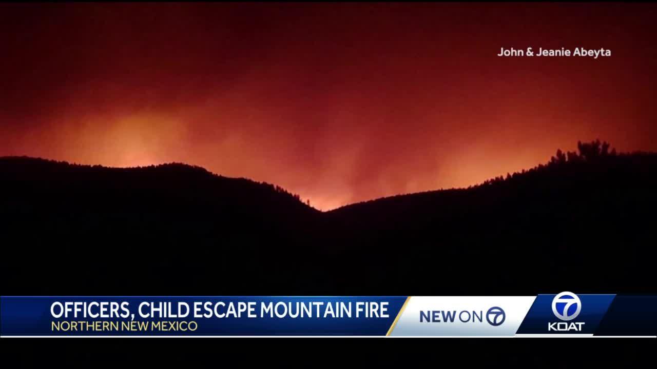 Four men, child escape massive fast moving forest fire