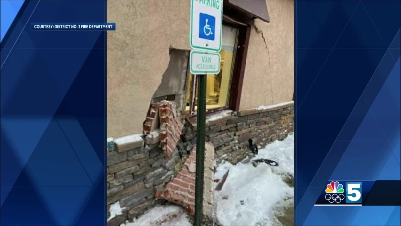 Police: Driver ticketed after crashing into bank