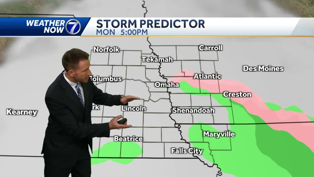Cloudy, windy, cooler Monday with spotty rain/snow chances