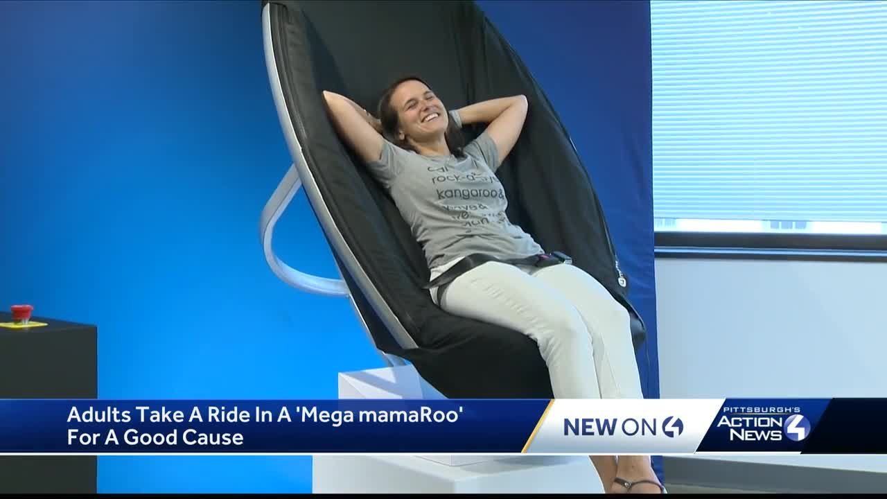 Adults take a ride in a 'Mega mamaRoo' for a good cause