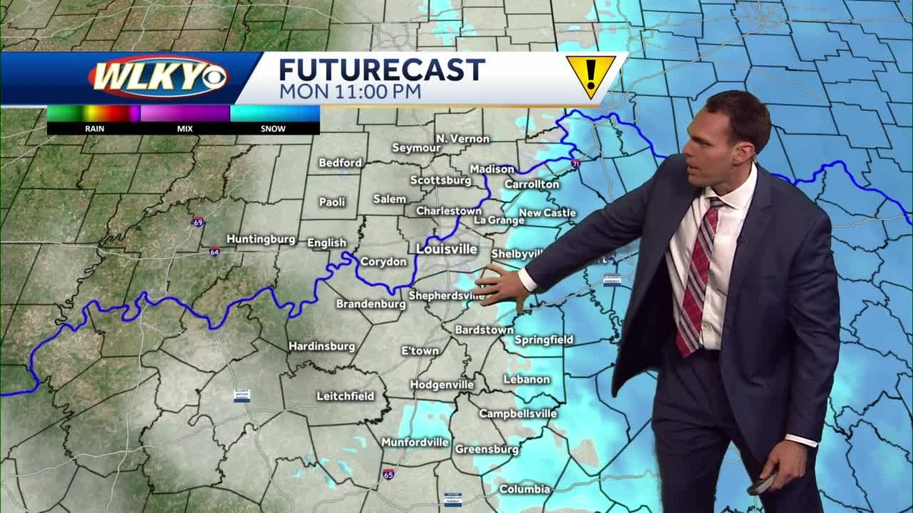 Breezy & cold with snow showers