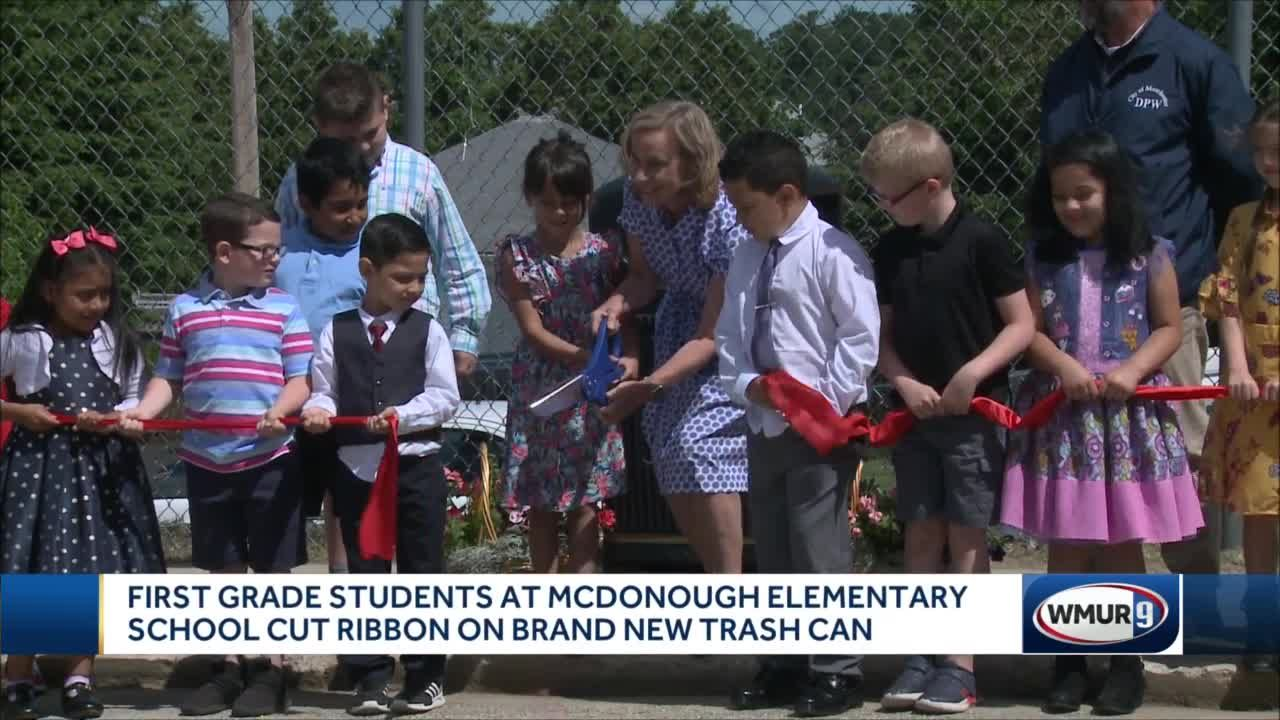 First graders at McDonough Elementary School cut ribbon on brand new trash can