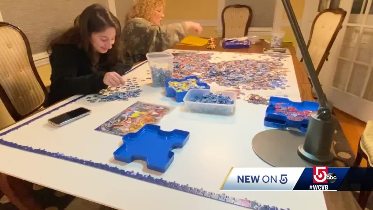 Giant puzzle brings neighbors together during COVID-19 pandemic