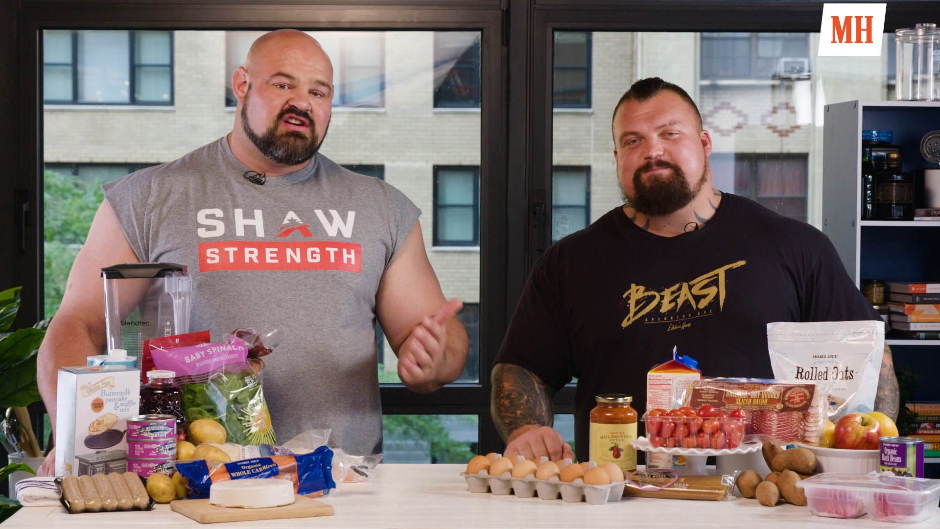 Watch World's Strongest Man Brian Shaw Take on a Navy SEAL in a Pullup Contest