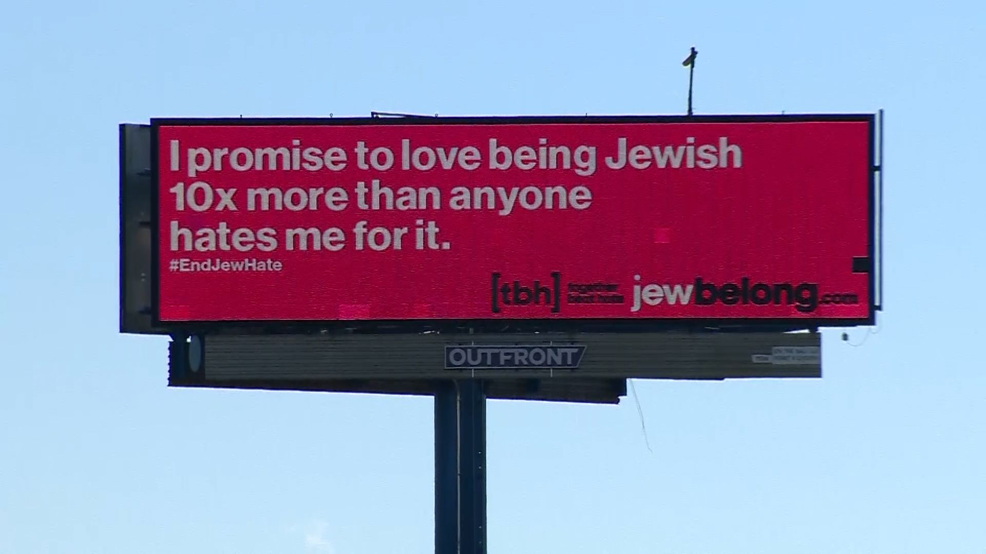 Bright pink billboards calling out antisemitism spotted around Greater Boston area