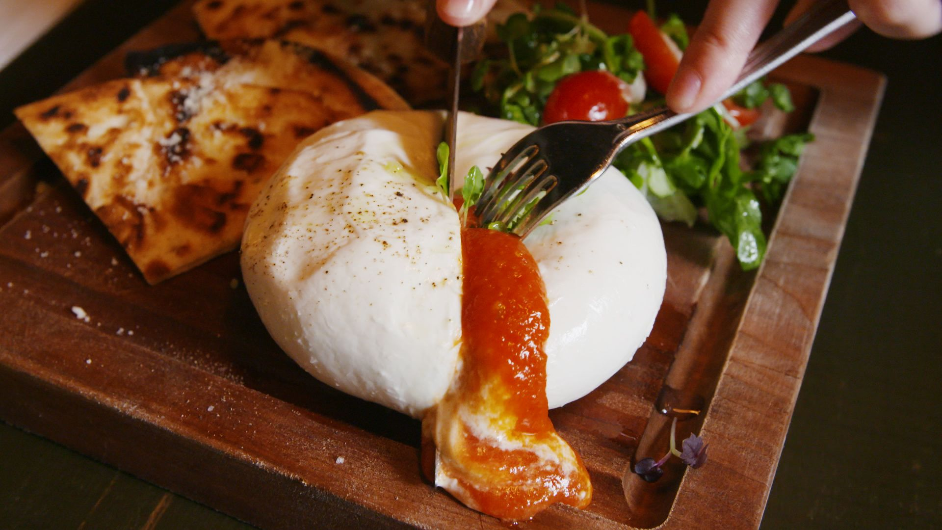 This Burrata Is Stuffed With Pizza Sauce And Even More Cheese