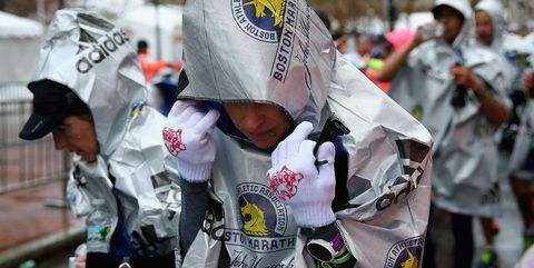 Runner Warming Up After Cold and Rainy Race