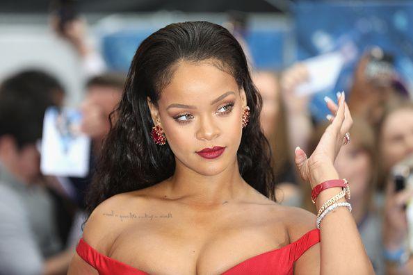 Rihanna Rocked a Gold Sequin Halter Dress at Roc Nation's Pre-Grammys Brunch