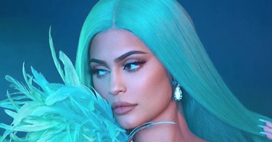 Kylie Jenner Is a Literal Christmas Gift in the Kylie Cosmetics Holiday Collection Advert