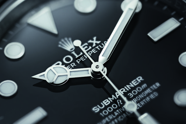 a close up image of the face of the new rolex submariner dive watch
