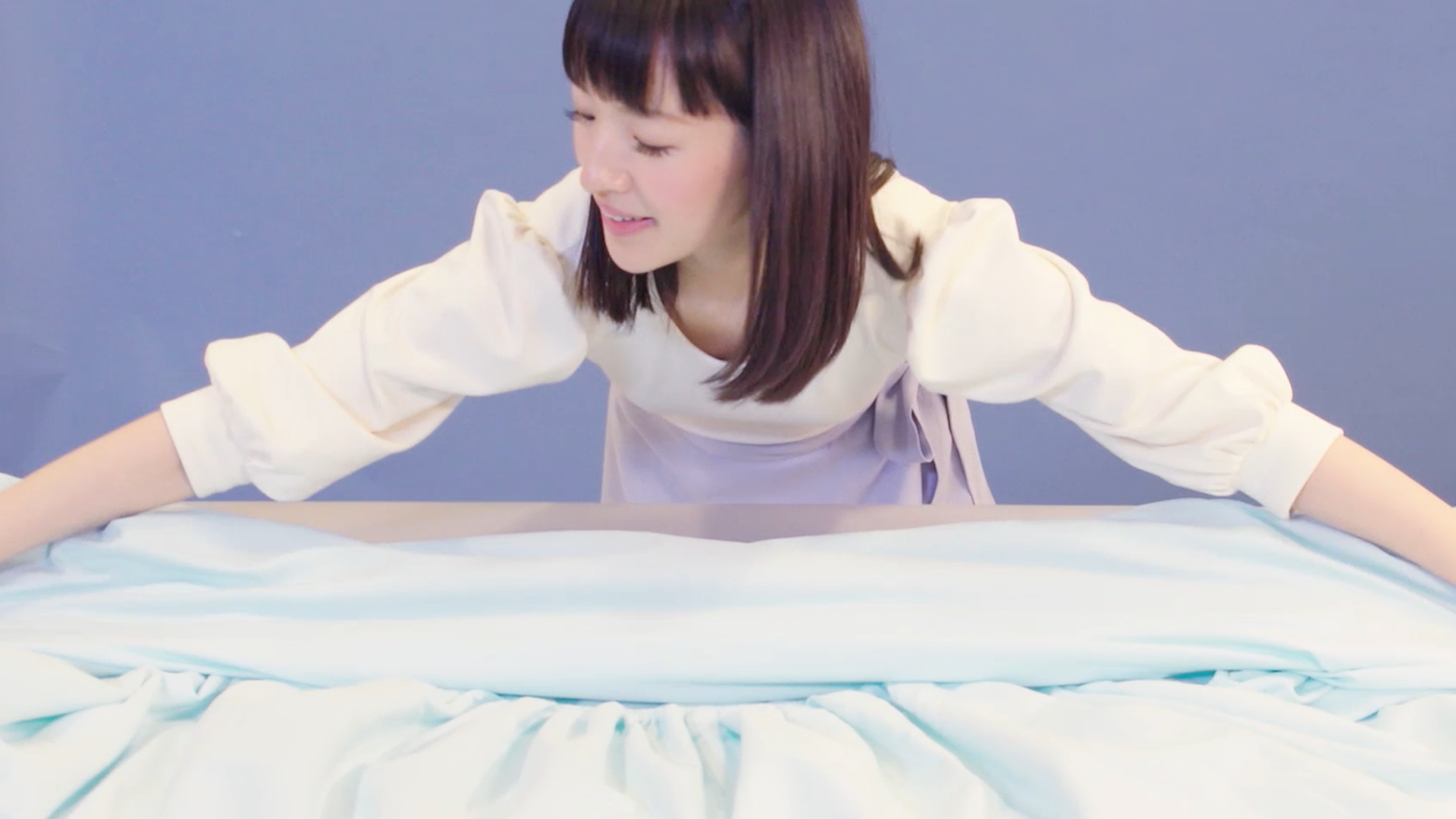 Here's Exactly How to Fold a Fitted Sheet, According to Marie Kondo