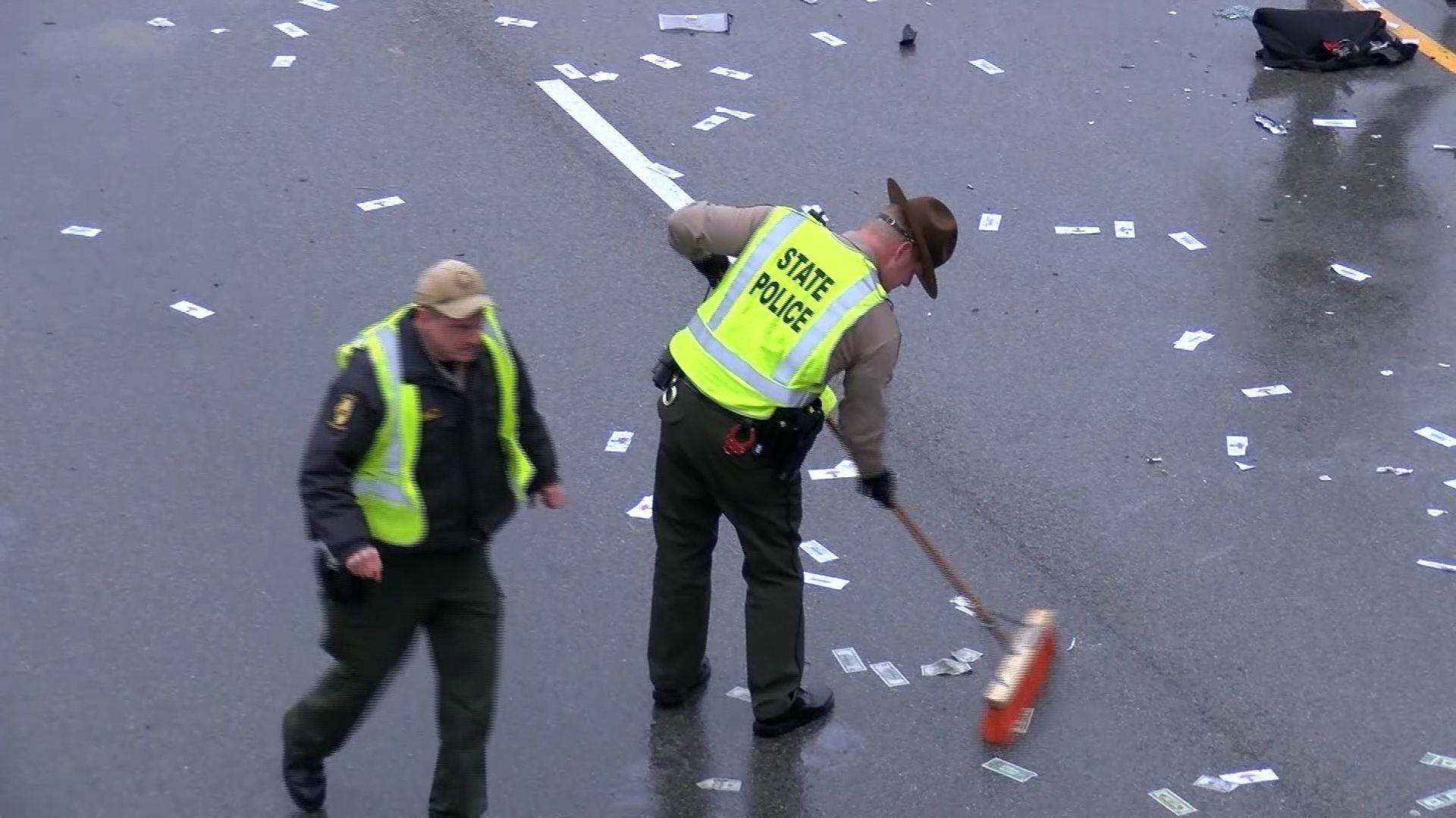 Illinois highway littered with cash after car accident