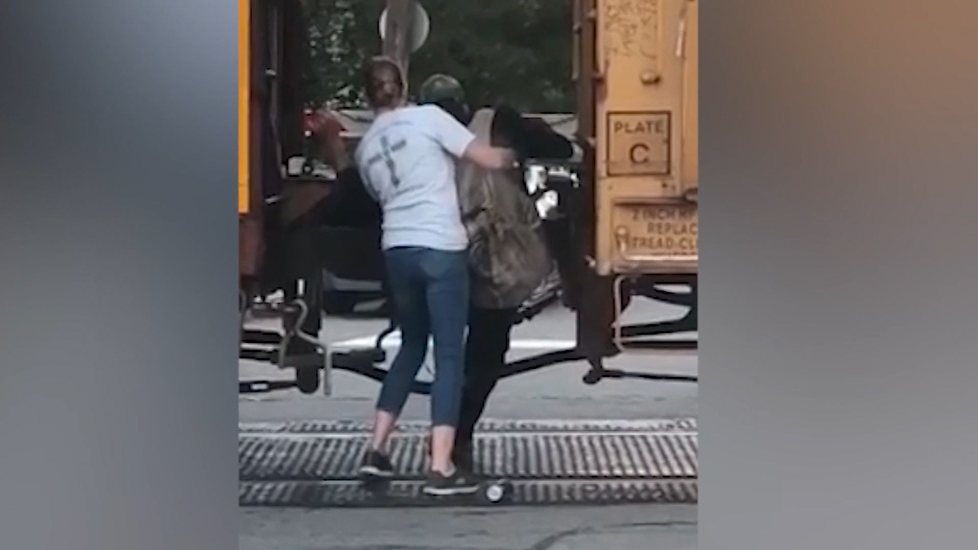 Caught on video: Woman jumps out of car to save man stuck between boxcars