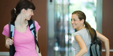 women passing each other at the gym