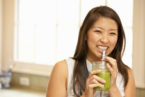 woman sipping smoothie