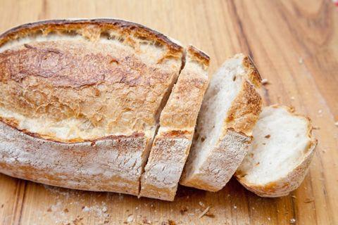 Bread, Wood, Food, Baked goods, Hardwood, Loaf, Snack, Gluten, Cuisine, Finger food,