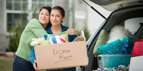 mother and daughter packing car for college