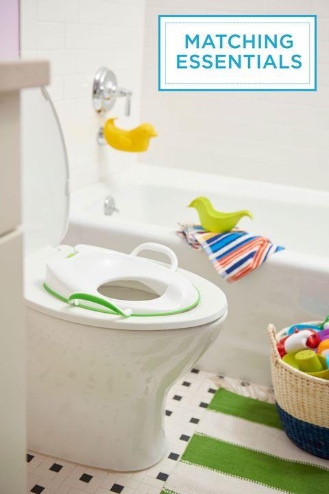 "<p>Potty training is easier when your kiddo <em>likes</em> being in the bathroom. A fun rug that matches his potty seat helps make the room his own. (Tuck a step stool beneath the vanity to give your little one access to the toilet and sink.) </p><p><em>Potty seat, <a href=""http://www.munchkin.com/"" target=""_blank"">Munchkin.com</a>; duck spout and bath toys, <a href=""http://www.skiphop.com/"" target=""_blank"">SkipHop.com</a></em><br></p>"