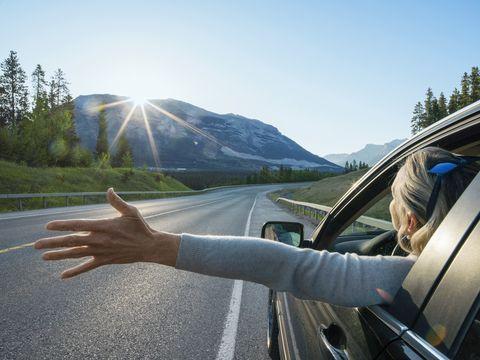 Road, Automotive mirror, Infrastructure, Glass, Mountainous landforms, Asphalt, Vehicle door, Highway, Windshield, Mountain range,
