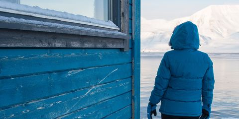 Blue, Winter, Standing, Turquoise, Wall, Freezing, Outerwear, Snow, Electric blue, Architecture,