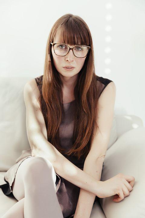 Eyewear, Glasses, Vision care, Lip, Hairstyle, Human leg, Shoulder, Joint, Elbow, Sitting,