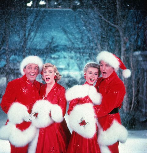 Bing Crosby (1903 - 1977), Rosemary Clooney (1928 - 2002), Vera-Ellen (1921 - 1981), and Danny Kaye (1913 - 1987) sing together, while dressed in fur-trimmed red outfits and standing in front of a stage backrop, in a scene from the film 'White Christmas,' directed by Michael Curtiz, 1954.
