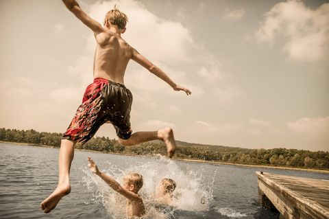 boys swimming in a lake