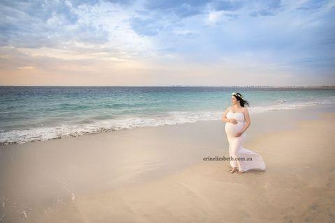 Body of water, Coastal and oceanic landforms, Shore, Elbow, Ocean, Summer, Dress, Beach, Sand, Sea,