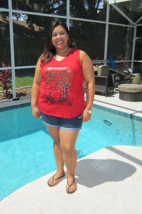 Shoulder, Human leg, Swimming pool, Joint, Leisure, Summer, Aqua, Shorts, Azure, Slipper,