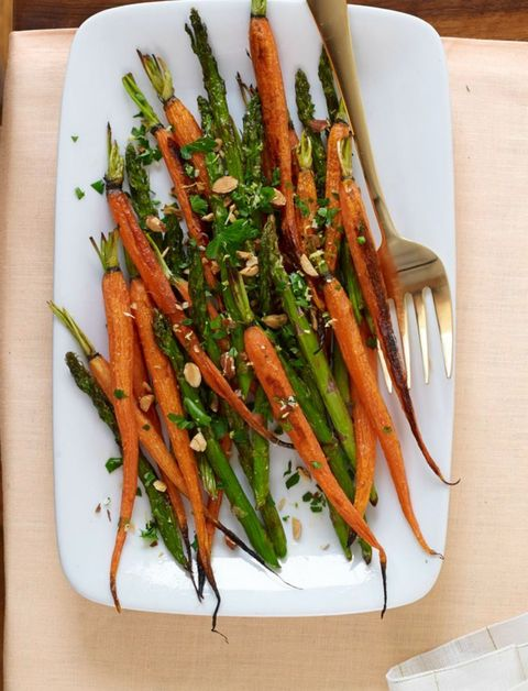 Recipe for roasted carrots and asparagus with almond gremolata.