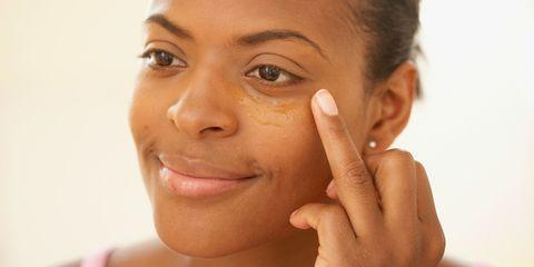 Finger, Lip, Cheek, Brown, Skin, Chin, Forehead, Eyebrow, Eyelash, Facial expression,