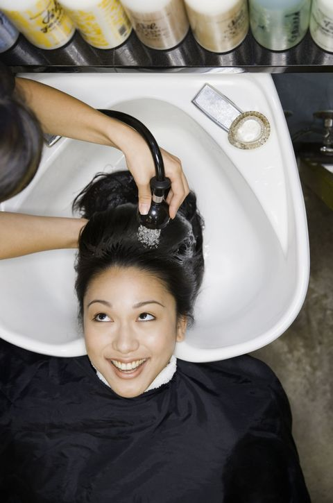 Smile, Hairstyle, Black hair, Costume accessory, Plumbing fixture, Ceramic, Hair accessory, Plumbing, Makeover, Personal grooming,