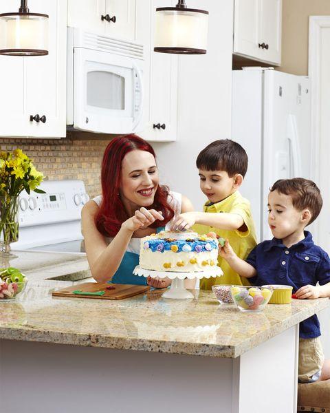Room, Child, Light fixture, Dessert, Cake, Cuisine, Sharing, Baked goods, Sweetness, Kitchen,