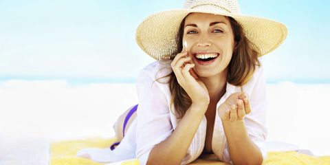 Hat, Skin, Human body, Happy, People in nature, Facial expression, Headgear, Fashion accessory, Sitting, Sun hat,