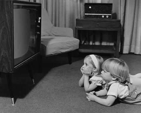 Comfort, Room, Display device, Child, Television set, Floor, Flooring, Interior design, Television, Baby & toddler clothing,