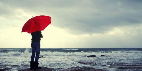 Body of water, Umbrella, Water, Coastal and oceanic landforms, Jeans, Fluid, Ocean, People in nature, Carmine, Sea,
