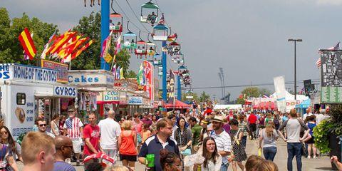 Hair, Face, Crowd, People, Event, Public space, Tourism, Pole, Public event, Street light,