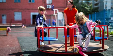 Fun, Recreation, Public space, Leisure, Play, Outdoor play equipment, Human settlement, Seesaw, Playing sports, Sunglasses,