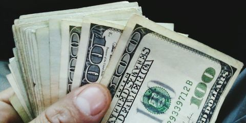 Skin, Banknote, Money, Currency, Paper product, Cash, Paper, Number, Material property, Money handling,