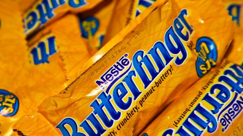 Yellow, Logo, Junk food, Convenience food, Finger food, Packaging and labeling, Number, Label,