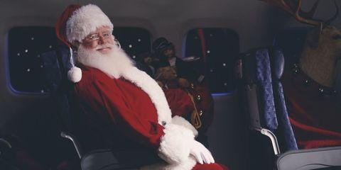 Deer, Santa claus, Antler, Sitting, Beard, Facial hair, Horn, Elk, Reindeer, Lap,