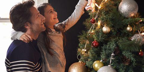 Human, Event, Christmas decoration, Christmas ornament, Christmas tree, Holiday ornament, Christmas eve, Interior design, Holiday, Ornament,