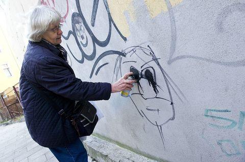 Jeans, Wall, Graffiti, Artist, Street fashion, Painter, Street art, Artwork, Mural, Visual arts,