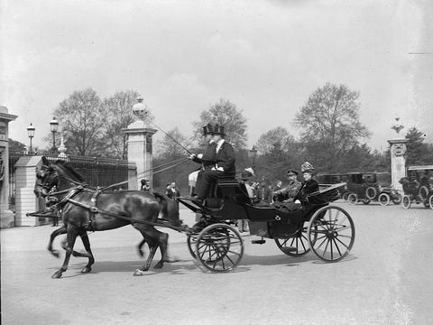 """<p>Queen Mary and King George V leaves <a href=""""http://www.townandcountrymag.com/society/tradition/news/a7820/tour-buckingham-palace/"""" target=""""_blank"""" data-tracking-id=""""recirc-text-link"""">Buckingham Palace</a>.&nbsp;<span class=""""redactor-invisible-space"""" data-verified=""""redactor"""" data-redactor-tag=""""span"""" data-redactor-class=""""redactor-invisible-space""""></span></p>"""
