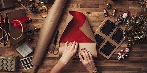 Finger, Wrist, Nail, Carmine, Christmas decoration, Holiday, Christmas ornament, Ornament, Christmas, Nail care,