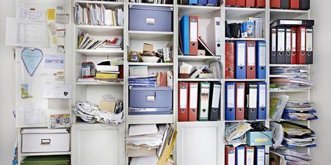 cluttered open shelf office