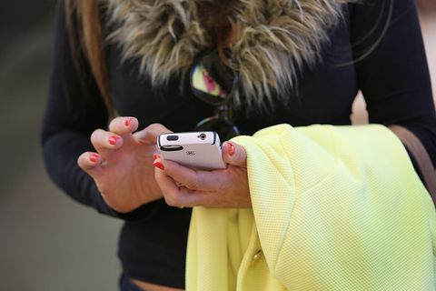 Finger, Joint, Mobile phone, Wrist, Nail, Communication Device, Portable communications device, Street fashion, Fur, Gadget,