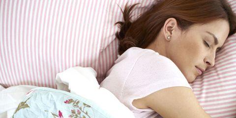 Ear, Comfort, Textile, Eyelash, Linens, Long hair, Earrings, Ponytail, Sleep, Nap,