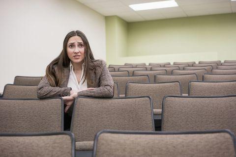 Comfort, Sitting, Long hair, Auditorium, Beanie, Armrest,